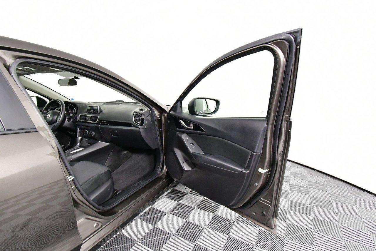 Photo Mazda Mazda3 GX. Low kilometers. Fuel economy. 2015 bas kilometrage