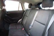 2015 Mazda CX-5 GX w/backup cam, alloy, $142.24 B/W