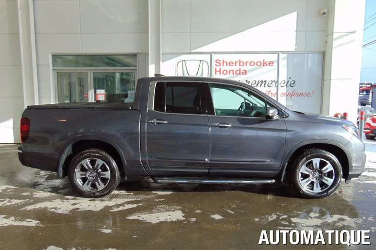 Pre owned 2017 honda ridgeline touring in sherbrooke pre for Honda used inventory